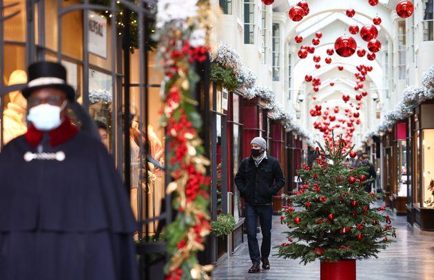 People walk through the Burlington Arcade adorned with Christmas decorations, amid the coronavirus disease...