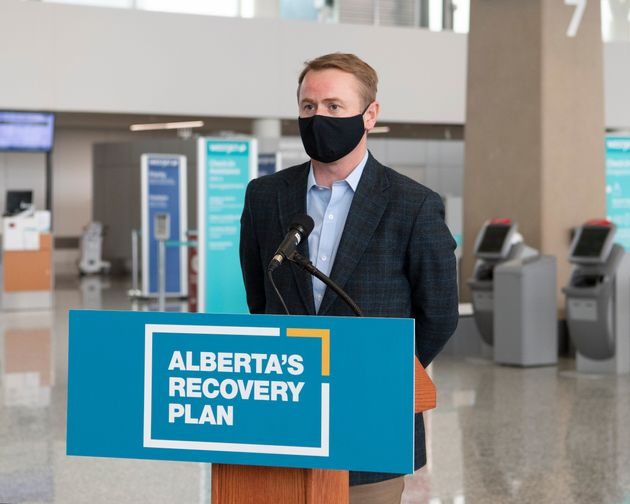 Alberta Health Minister Tyler Shandro speaks during an announcement at the Calgary International Airport...