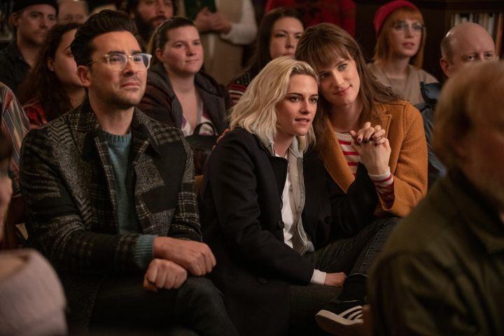 "Dan Levy, Kristen Stewart and Mackenzie Davis in ""Happiest Season."""