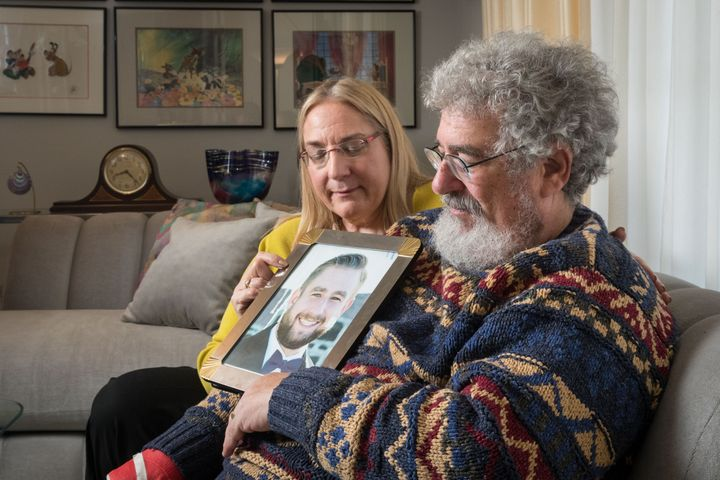 Mary Rich and her husband, Joel Rich hold a photo of their son in their home in Omaha, Nebraska, on Jan. 11, 2017.