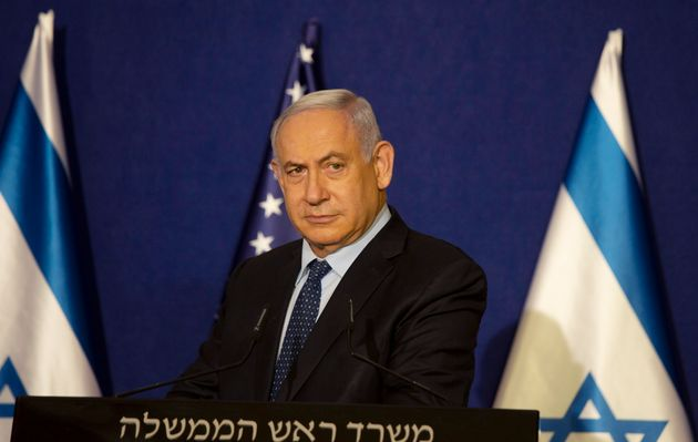 Israeli Prime Minister Benjamin Netanyahu listens during a news conference in Jerusalem, Thursday, Nov....