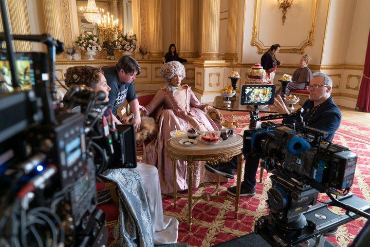 Director Tom Verica discussing a scene on set for Bridgerton
