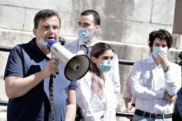 ROME, ITALY - MAY 27 : Carlo Calenda with megaphone intervenes at the Young Doctors' demonstration, on...