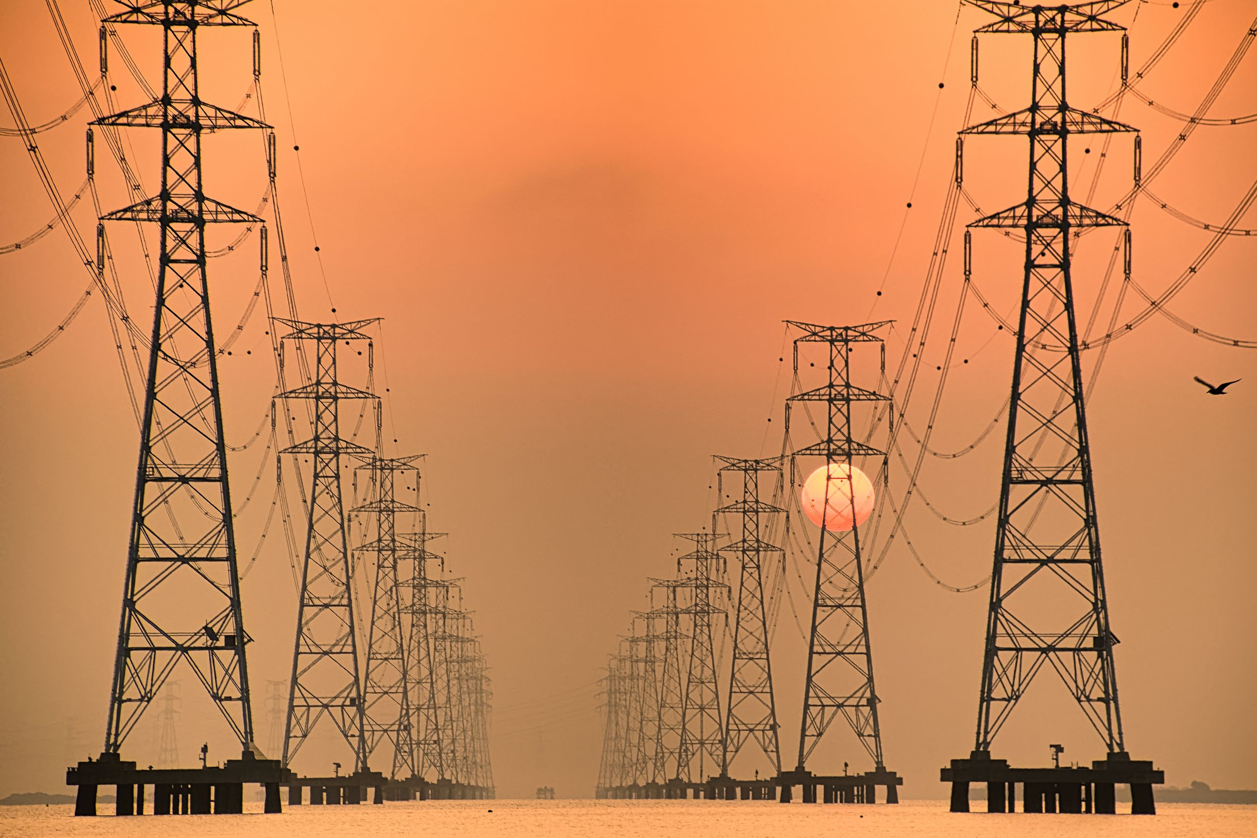 The sun rises behind Sihwa Lake Pylon VD702. The Sihwa Lake Tidal Power Station in South Korea is the world's largest tidal a