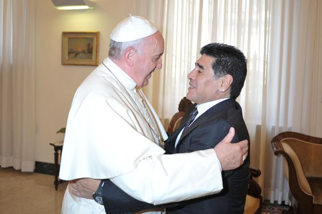 Pope Francis greets Argentinian former football star Diego Armando Maradona prior to a meeting with members...