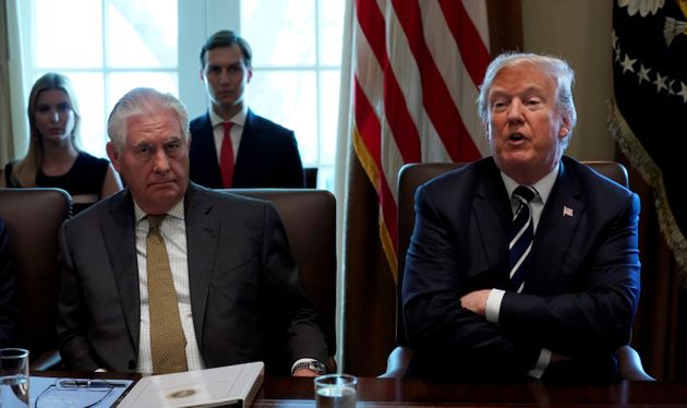 President Donald Trump had little familiarity with his first secretary of state, Rex Tillerson (left),...