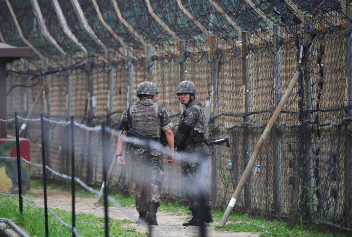 South Korean soldiers patrol a fence in the Demilitarized Zone (DMZ) dividing the two Koreas in Goseong on June 14, 2019.