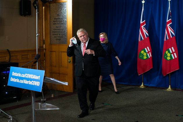Ontario Premier Doug Ford and Health Minister Christine Elliott arrive at a news conference at the Ontario...