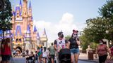 Guests wear required face masks due to the Covid-19 pandemic on Main Street, U.S.A. in front of Cinderella Castle at Walt Disney World Resort's Magic Kingdom on Wednesday, August 12, 2020, in Lake Buena Vista, Fla. (Photo by Charles Sykes/Invision/AP)