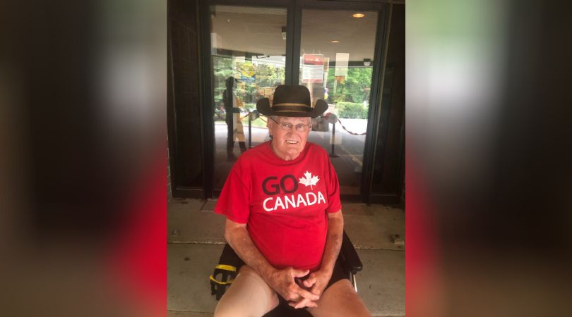 Glen Baillie in front of Maples Personal Care Home for a drive-by with the mascots and cheerleaders from...