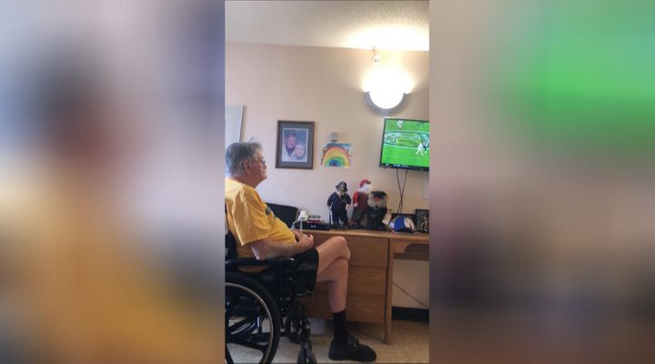 Glen Baillie watches football in his room at Maples Personal Care Home.
