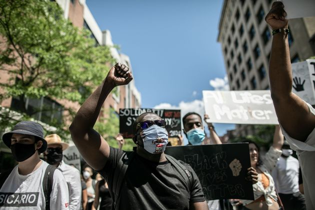 Protesters march against police brutality and racism in Montreal on June