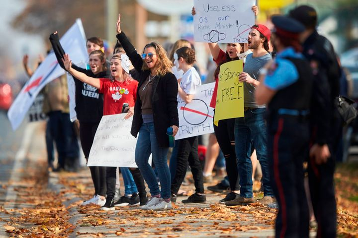 Anti-mask protesters march outside the community centre in Aylmer, Ont., on Nov. 7.