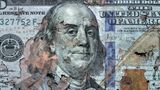 conceptual finance image of close up torn American one hundred dollar bill