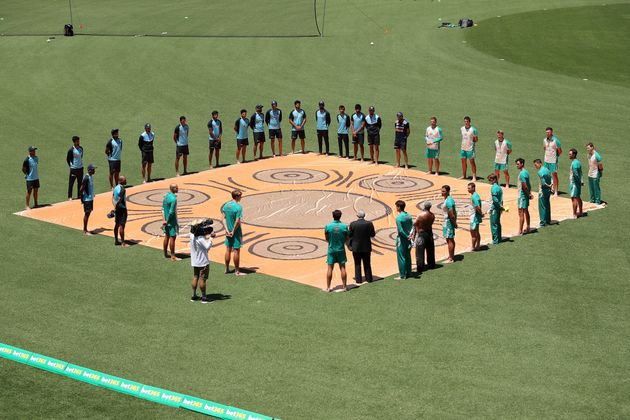 Australian and Indian players participate in a Barefoot Ceremony ahead of game one of the One Day International...