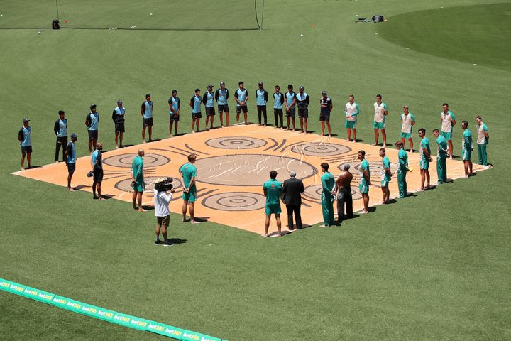Australian and Indian players participate in a Barefoot Ceremony ahead of game one of the One Day International series between Australia and India at Sydney Cricket Ground on November 27/