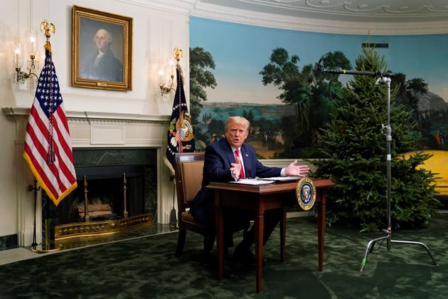 President Donald Trump spoke with reporters following a video chat with members of the military and the...