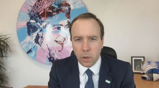 Health secretary Matt Hancock on a video call this year. Hancock's office contains a large portrait of...