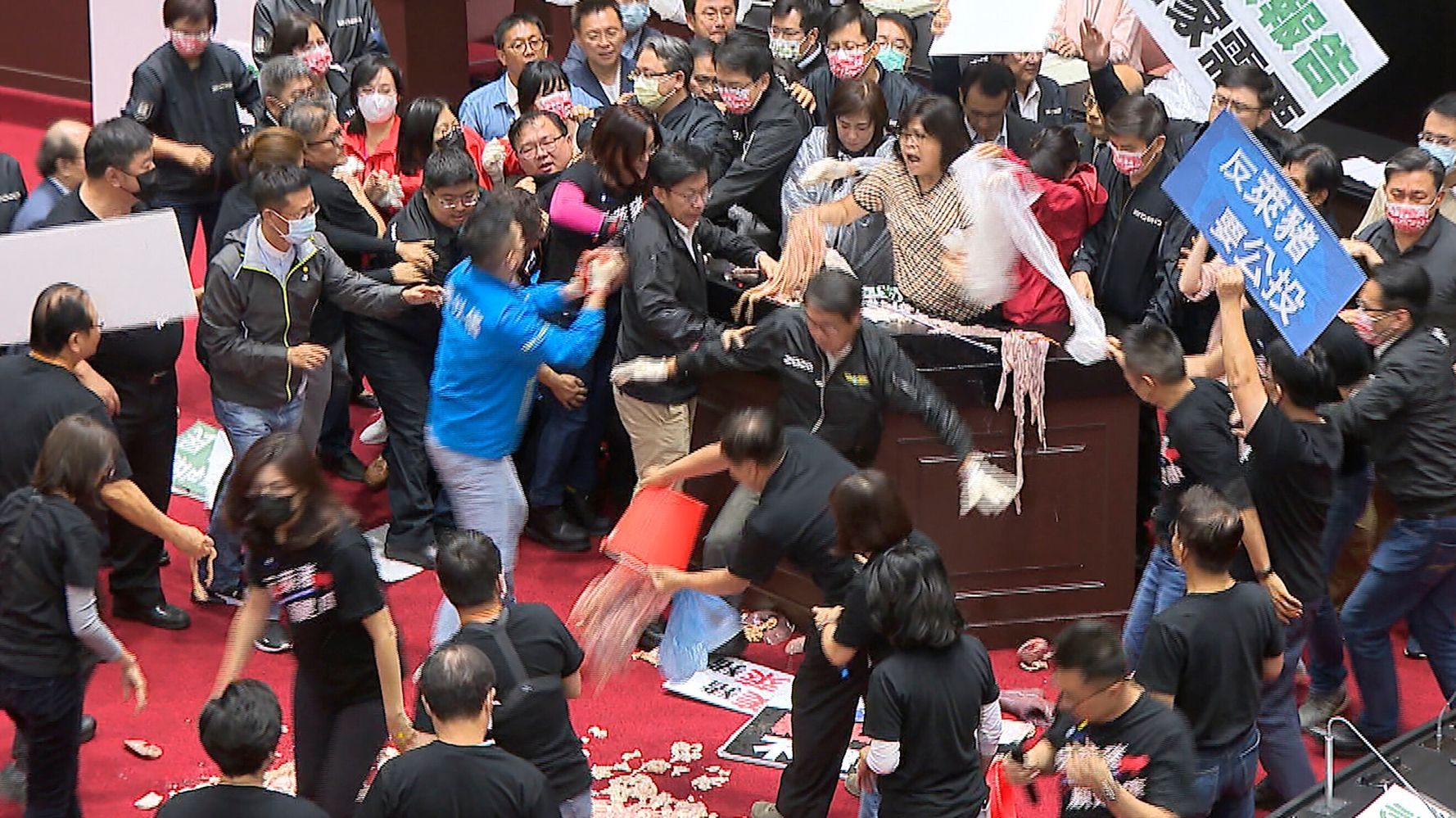Pig Guts And Punches Fly In Taiwan Parliament Over Imports Of U.S. Meat