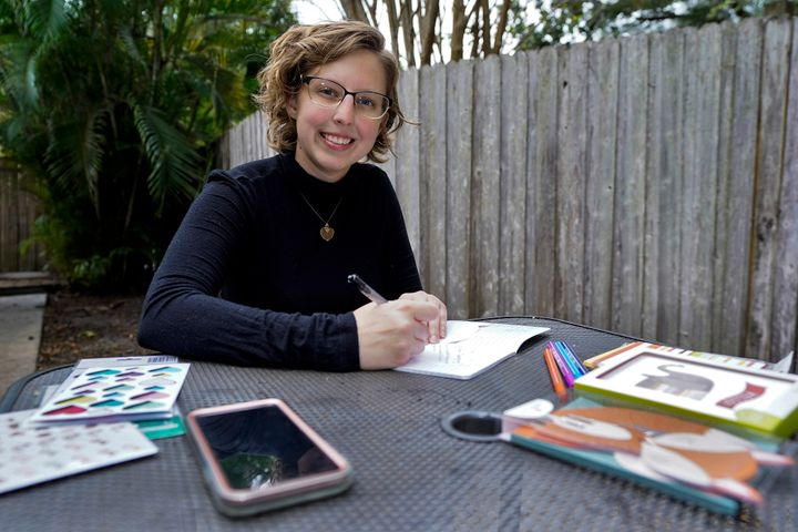 Kara McKlemurry poses for a photo while writing Thanksgiving notes to family and friends at her home Thursday, Nov. 19, 2020,
