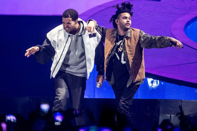 Drake and The Weeknd perform onstage during Drake's