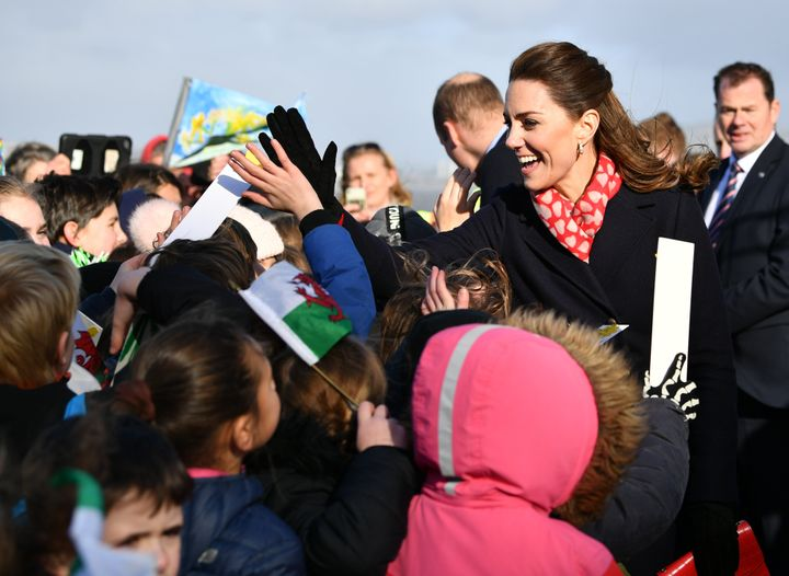 Kate Middleton high fives children as she leaves the RNLI Mumbles Lifeboat Station on February 04, 2020 near Swansea, South Wales.