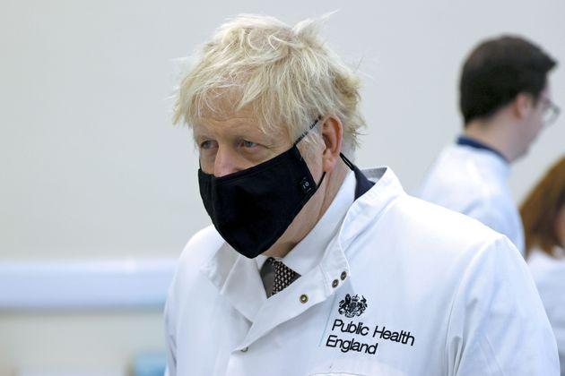 Prime Minister Boris Johnson during a visit to Public Health England (PHE) Porton Down, at Porton Down...