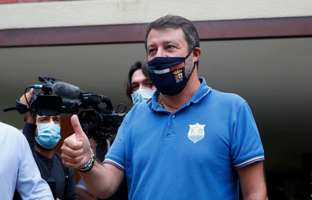 Right-wing opposition leader Matteo Salvini leaves a polling station, in Milan, Italy, Monday, Sept....