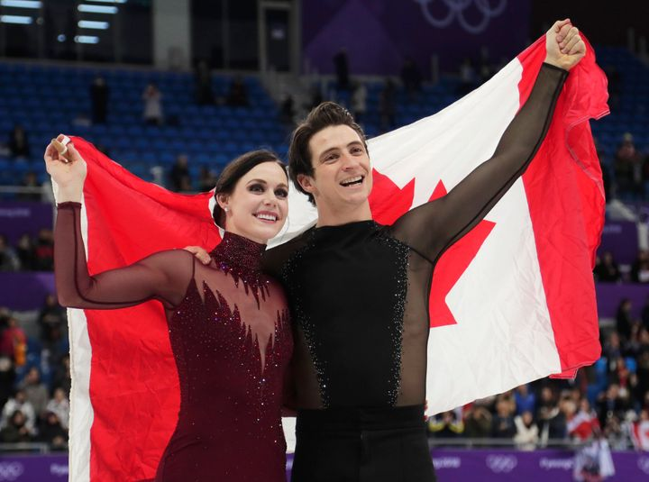 Tessa Virtue and Scott Moir of Canada celebrate  after winning the gold medal in the ice dance at the 2018 Winter Olympics in Gangneung, South Korea on Feb. 20, 2018.