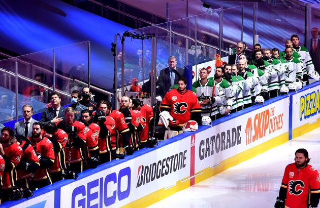 The Calgary Flames and the Dallas Stars benches are seen during pregame for game six of the western conference...
