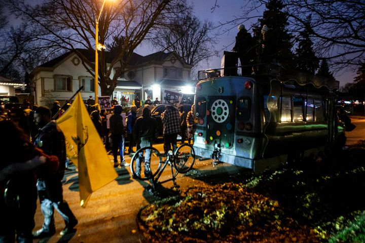 Protesters gather outside of Ontario Premier Doug Ford's home following the arrest of Adam Skelly in Etobicoke, Ont. on Nov. 26, 2020. Skelly owns a BBQ restaurant which opened in defiance of COVID-19 restrictions.