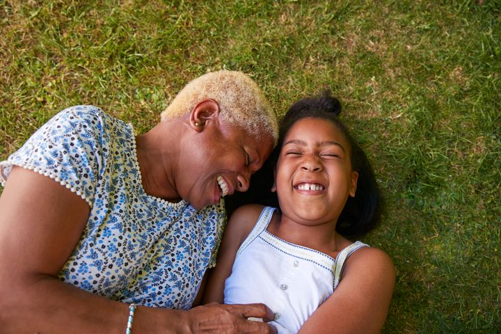 A stock image of a kinship carer and their child.