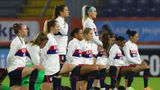 "United States players wear a sweater with the slogan ""Black Lives Matter"" and most take the knee as the national anthem is played prior to the international friendly women's soccer match between The Netherlands and the US at the Rat Verlegh stadium in Breda, southern Netherlands, Friday Nov. 27, 2020. (Dean Mouhtaropoulos/Pool via AP)"