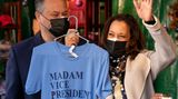 "Vice President-elect Kamala Harris, accompanied by her husband Doug Emhoff, left, holds up a shirt that reads ""Madam Vice President"" as they visit the ""made in DC"" booth in the Downtown Holiday Market, Saturday, Nov. 28, 2020, in Washington. (AP Photo/Andrew Harnik)"