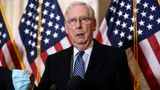 Senate Majority Leader Mitch McConnell, R-Ky., holds a face mask as he talks briefly to reporters after the Republican Conference held leadership elections, on Capitol Hill in Washington, Tuesday, Nov. 10, 2020. (AP Photo/J. Scott Applewhite)