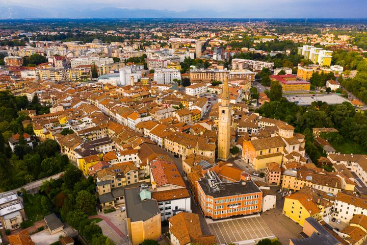 Scenic cityscape from drone of Italian town of Pordenone in sunny day, Italy