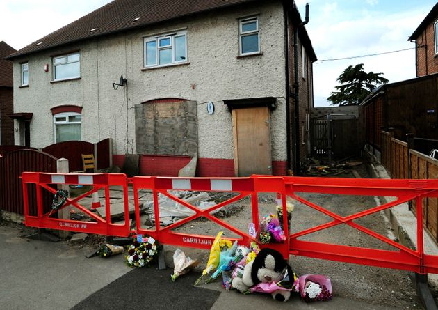 File photo dated 04/04/13 of tributes outside the house in Allenton,
