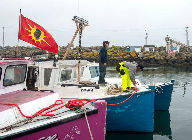 Indigenous fishermen adjust lines on their boat in Saulnierville, N.S. on Oct. 21,
