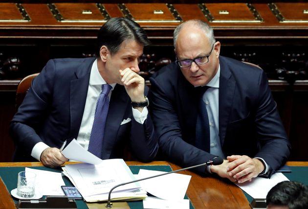 Italian Prime Minister Giuseppe Conte talks to Economy Minister Roberto Gualtieri ahead of a confidence...