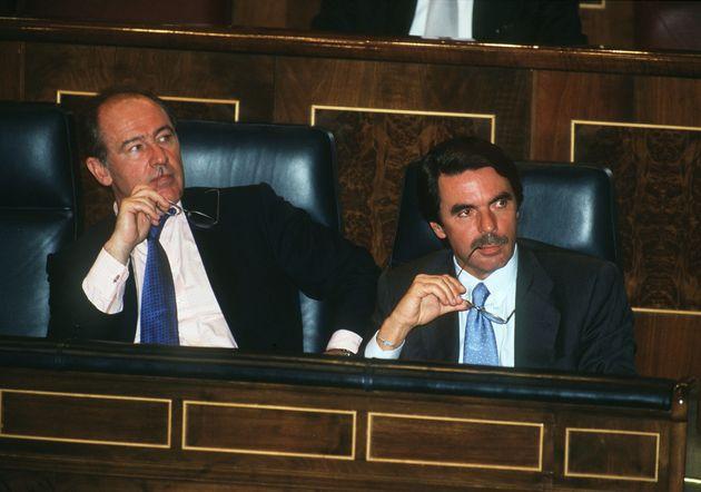 Rato y Aznar en el