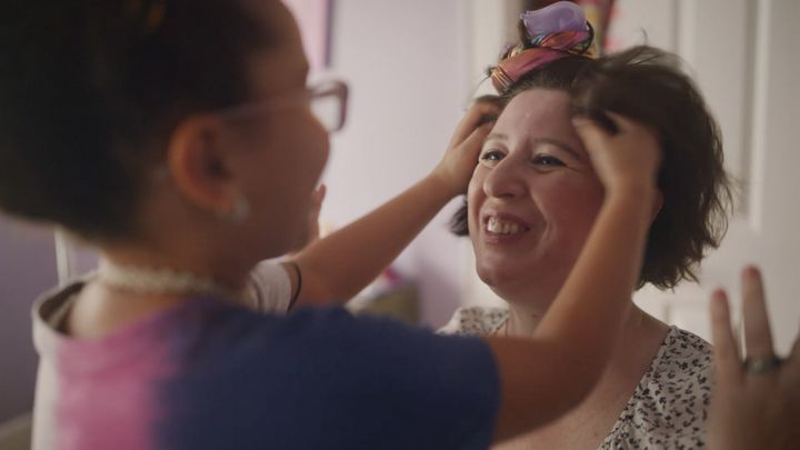 <strong>Eliza tries out her burgeoning hair styling skills on her mother. </strong><br>(Photograph: Courtesy of Pantene)
