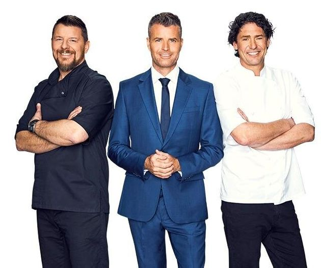 Colin Fassnidge (R) starred on 'My Kitchen Rules' alongside Manu Feildel (L) and Pete Evans
