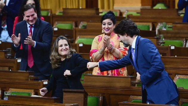 Minister of Finance Chrystia Freeland gets a fist bump from Prime Minister Justin Trudeau after delivering...