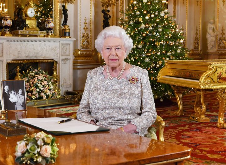 Queen Elizabeth II poses for a photo after she recorded her annual Christmas Day message, in the White Drawing Room at Buckin