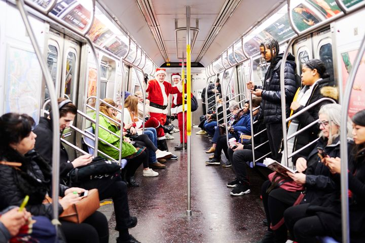 People ride the New York City subway on Dec. 14, 2019. New research suggests that the coronavirus was in the U.S. in late 201