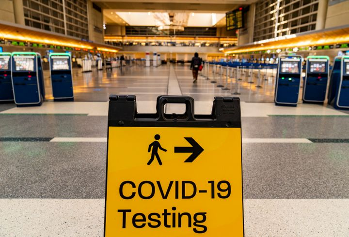 A COVID-19 testing sign at the empty Tom Bradley International Terminal at Los Angeles International Airport on Nov. 25, 2020