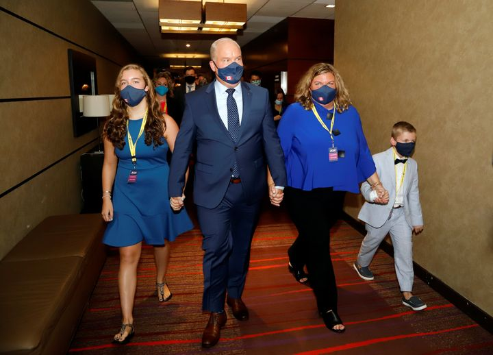 Erin O'Toole walks with his family, wife Rebecca, daughter Mollie, and son Jack, to give his victory speech as the new leader of Canada's main opposition Conservative Party in Ottawa on Aug. 24, 2020.