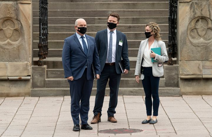 Conservative Leader Erin O'Toole, chief of staff Tausha Michaud and campaign manager Fred DeLorey wait to cross a road as they walk to national caucus, Sept. 9, 2020 in Ottawa.