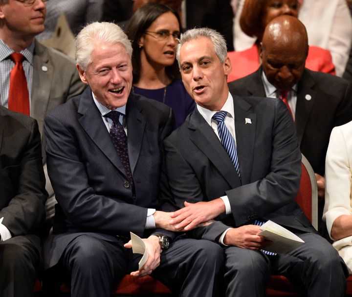Emanuel bonds with former President Bill Clinton in 2015. As an aide to Clinton, Emanuel helped drive the North American Free