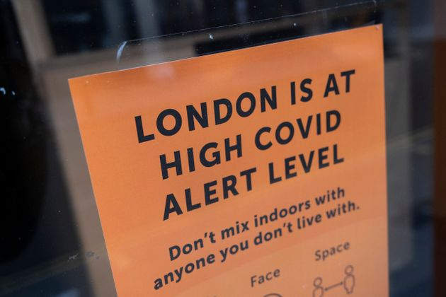 London is at high Covid alert level sign in a shop
